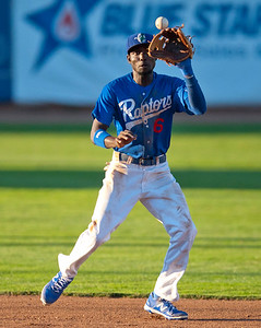 Raptors short stop Faustino Oguisten #6 catches the ball for a out and throws another runner out at first base At Lindquist Field in Ogden on June 26, 2015.