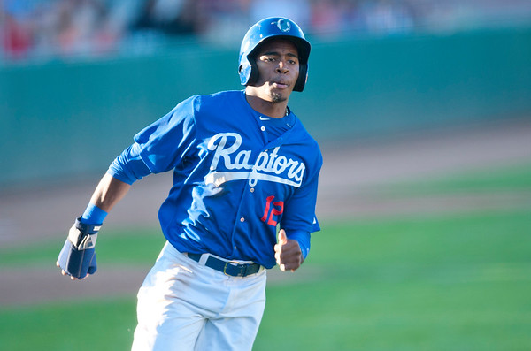 Daivy Castillo #12 scores a run for the Raptors against Grand Junction Rockies At Lindquist Field in Ogden on June 26, 2015.