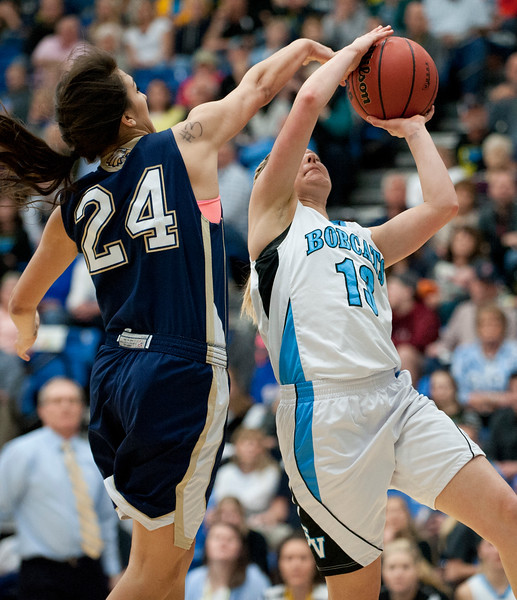 Skyline's Olivia Ellis #4 tires to block the unclose shot by Alyssa Walker #13 . During the Girls Basketball State Championships. At Salt Lake Community College on February 21, 2015.