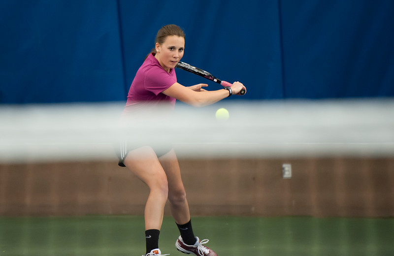 Hailey Daniels from Bonneville High School attacks the ball at practice at the Ogden Athletic Club. The tennis program at Ogden Athletic Club has really taken off lately and has always been successful. In Ogden, On February 24, 2014. (Brian Wolfer Special to the Standard-Examiner)