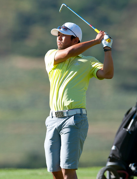 Brandon Kida from Layton shoots a iron shot at the Utah State Amateur Championship held at Soldier Hollow Golf Course in Midway on July 10, 2015.