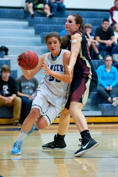 Guard Liva Borges #35  dibbles the  ball around the Viewmont defender. At Layton High School On Tuesday February 10, 2015.