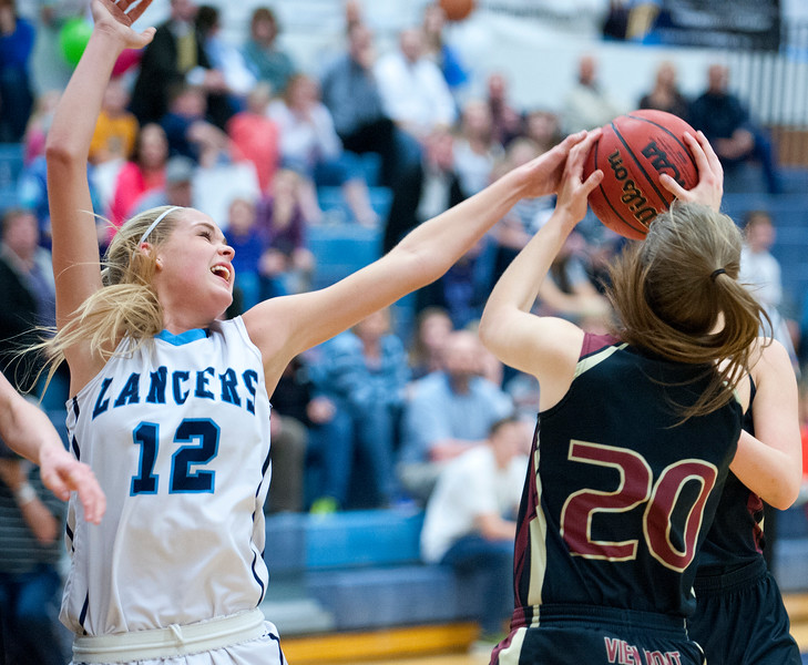 Hailey Bassett #12 disrupts the shot of Sky Fenwick's #20 shot. At Layton High School On Tuesday February 10, 2015.