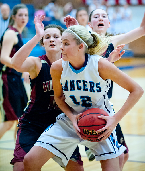 11th grader Hailey Bassett #12 looks for a open teammate to pass to during the game against Viewmont High school.