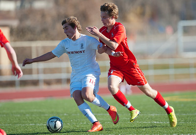 Viewmonts #18 and Mason Hoffman #17 battle for possession of the ball. At Viewmont High School in Bountiful on March 6, 2015.