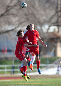 Bountiful teammates Zac Paxton # 28 and Mason Hoffman #17 both try to head the ball.  At Viewmont High School in Bountiful on March 6, 2015.