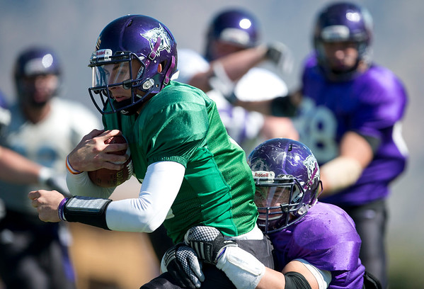 QB Jadrian Clark gets dragged to the ground by the defender close to the goal line. At Stewart Stadium in Weber State University on April 18, 2015