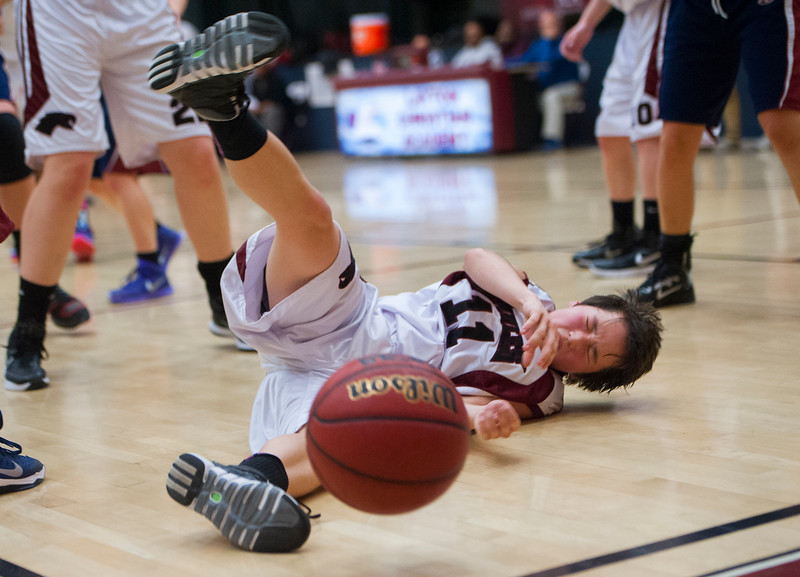 10th grader Heather Martin-Chan #11 takes a hard fall on the court. She was shaking up a little but got right back into the game. On Thursday at the Layton Christian Academy on  January 29, 2015.