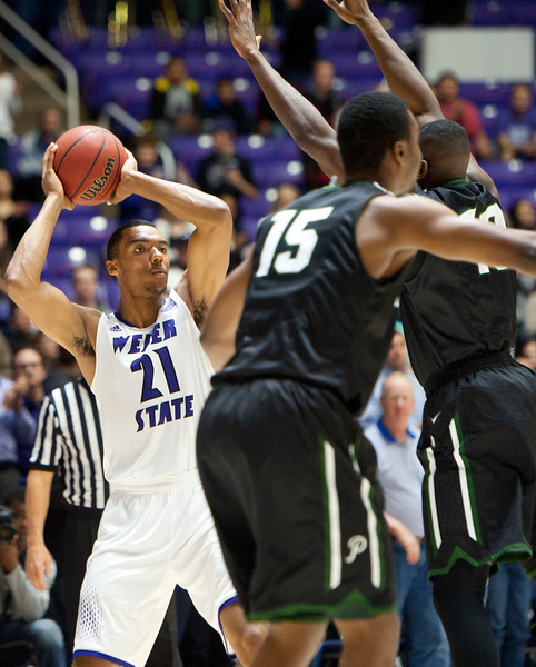 Weber State's Joel Bolomboy #21 looks for a open team-mate to pass. Weber State basketball vs Portland State at the Dee Event Center In Ogden on January 22, 2015.