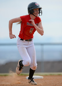 Weber High School's Meagan Bull steals third base against Bear River during the girls softball game. At Weber High School in Pleasant View on March 17, 2015.