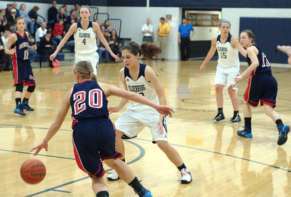 Staff photo by Bryan Helvie<br /> Pressure defense: Oldenburg Academy's Cora Weisenbach leads the team's full court press against Southwestern.