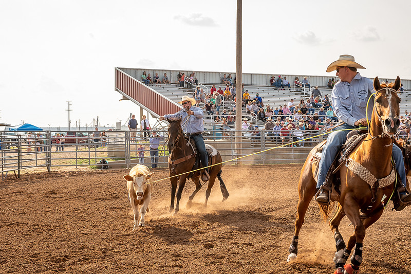 Cowboy from the Climer Cattle Company ropes a calf during the ranch rodoe. Taken at Oliver Saddle Shop Ranch Rodeo held at Range Riders in Amarillo, TX on July 28, 2018. [Shaie Williams for Amarillo Globe News]
