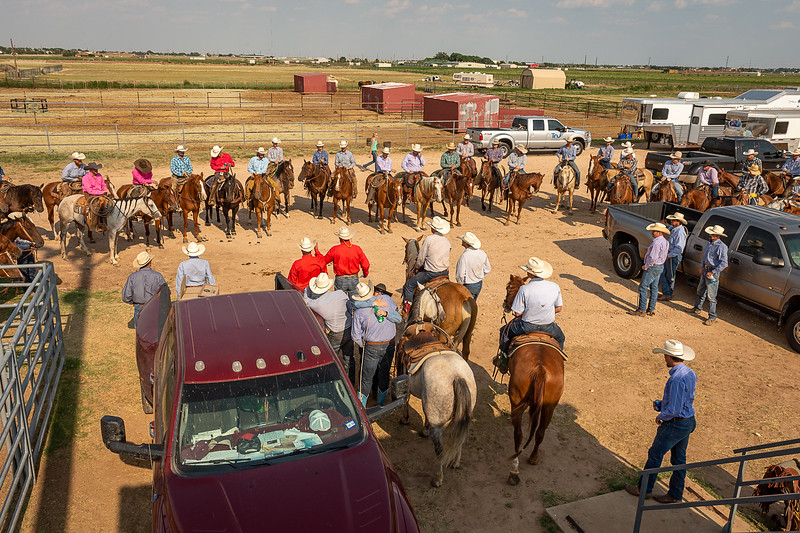 Ranch teams having a meeting before the ranch rodeo Taken at Oliver Saddle Shop Ranch Rodeo held at Range Riders in Amarillo, TX on July 28, 2018. [Shaie Williams for Amarillo Globe News]