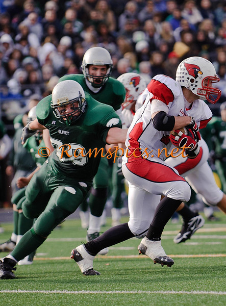 With the crowd in the stands, the ball carrier on the run and a BIG defender on his tail... luv this shot!
