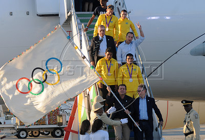 President of Rio 2016 Commite, Carlos Arthur Nuzman,  Mayor of Rio de Janeiro, Eduardo Paes, and atlhetes of Brazil arrive at the international airport of Rio de Janeiro with the Olympic flag, Rio de Janeiro, Brazil, August 13, 2012. (Austral Foto/Renzo Gostoli)