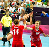 All kinds of contact takes place in Women's Handball.  Montenegro (in white) narrowly lost to Croatia, 3 August 2012