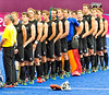 New Zealand hockey players line up for the anthems, they beat India 3-1