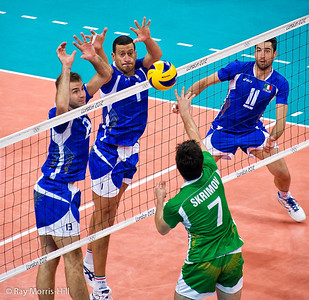Men's Volleyball, Bronze Medal Match, Italy vs Bulgaria.   Bulgaria's Skrimov tries to overcome the powerful defensive duo of Travica and Mastrangelo.