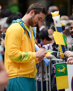 Boomers Basketball Point Guard Adam Gibson - Welcome home to Aussie Olympic Athletes; Queen Street Mall,City, Brisbane, Queensland, Australia; 24 August 2012. Photos by Des Thureson - http://disci.smugmug.com. (Camera 1) - Signing Autographs.