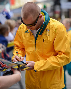 Welcome home to Aussie Olympic Athletes; Queen Street Mall,City, Brisbane, Queensland, Australia; 24 August 2012. Photos by Des Thureson - http://disci.smugmug.com. (Camera 1) - Signing Autographs.