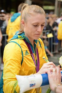 2012 Australian Olympic Hurdles Gold Medallist Sally Pearson - Welcome home to Aussie Olympic Athletes; Queen Street Mall,City, Brisbane, Queensland, Australia; 24 August 2012. Photos by Des Thureson - http://disci.smugmug.com. (Camera 1) - Signing Autographs.
