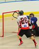 Onondaga Redhawks Andy Jamieson (26) scores on the Allegany Arrows at the Onondaga Nation Arena near Nedrow, New York on Saturday, May 3, 2014.  Onondaga won 21-5.