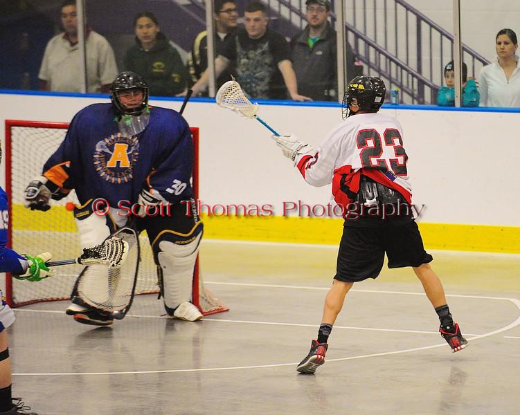 Onondaga Redhawks Dwayne Porter (23) scores on the Allegany Arrows at the Onondaga Nation Arena near Nedrow, New York on Saturday, May 3, 2014.  Onondaga won 21-5.