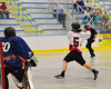 Onondaga Redhawks Cam Simpson (5) goes behind the back for a shot at the Allegany Arrows net at the Onondaga Nation Arena near Nedrow, New York on Saturday, May 3, 2014.  Onondaga won 21-5.