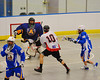 Onondaga Redhawks Troy Benedict's (10) shot is stopped by Allegany Arrows goalie Jake George (30) at the Onondaga Nation Arena near Nedrow, New York on Saturday, May 3, 2014.  Onondaga won 21-5.