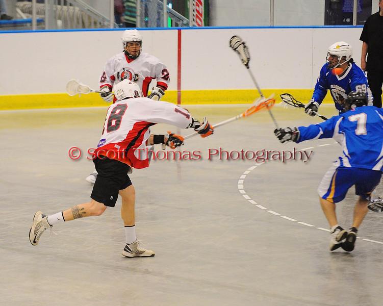 Onondaga Redhawks Corey Thompson (18) shoots and scores against the Allegany Arrows at the Onondaga Nation Arena near Nedrow, New York on Saturday, May 3, 2014.  Onondaga won 21-5.