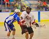 Onondaga Redhawks Neal Powless (16) setting up for a shot on the Allegany Arrows net at the Onondaga Nation Arena near Nedrow, New York on Saturday, May 3, 2014.  Onondaga won 21-5.