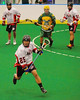 "Onondaga Redhawks Kevin Bucktooth (25) with the ball against the Newtown Golden Eagles in the Can-Am Senior ""B"" Box Lacrosse finals at the Onondaga Nation Arena near Nedrow, New York on Saturday, August 2, 2014.  Onondaga won 11-5."