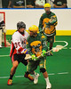 "Onondaga Redhawks Billy O'Brein (35) checks Newtown Golden Eagles Jake Davis (92) in the Can-Am Senior ""B"" Box Lacrosse finals at the Onondaga Nation Arena near Nedrow, New York on Saturday, August 2, 2014.  Onondaga won 11-5."