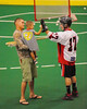 "Onondaga Redhawks Andy Jamerison (17) greets a young fan before playing the Newtown Golden Eagles in the Can-Am Senior ""B"" Box Lacrosse finals at the Onondaga Nation Arena near Nedrow, New York on Saturday, August 2, 2014.  Onondaga won 11-5."