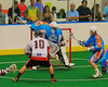 Onondaga Redhawks Pete Benedict (10) scores on Six Nations Slash goalie Tasha Nanticoke (78) at the Onondaga Nation Arena near Nedrow, New York on Sunday, June 29, 2014.  Onondaga won 30-6.