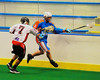 Onondaga Redhawks Mike Abrams (7) stick checks Six Nations Slash Brendon Morrison (8) at the Onondaga Nation Arena near Nedrow, New York on Sunday, June 29, 2014.  Onondaga won 30-6.