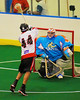Onondaga Redhawks Lyle Thompson (44) stretches out to slam in a goal over the Six Nations Slash goalie Marco Celic (58) at the Onondaga Nation Arena near Nedrow, New York on Sunday, June 29, 2014.  Onondaga won 30-6.