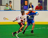 While driving to the net, Onondaga Redhawks Lyle Thompson (44) gets checked by Six Nations Slash Brendon Morrison (8) at the Onondaga Nation Arena near Nedrow, New York on Sunday, June 29, 2014.  Onondaga won 30-6.