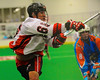 Onondaga Redhawks Brett Bucktooth (66) shoots and scores against the Six Nations Slash at the Onondaga Nation Arena near Nedrow, New York on Sunday, June 29, 2014.  Onondaga won 30-6.