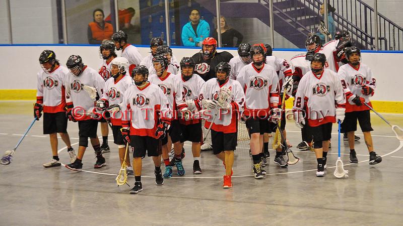 Onondaga Redhawks break the pre-game huddle before playing the Tuscaroa Tomahawks at the Onondaga Nation Arena near Nedrow, New York on Saturday, April 26, 2014. Onondaga won 8-7 in overtime.