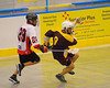 Onondaga Redhawks Paul Elm (29) chases Tuscaroa Tomahawks Anthony Printup (9) at the Onondaga Nation Arena near Nedrow, New York on Saturday, April 26, 2014. Onondaga won 8-7 in overtime.