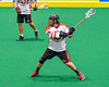 Onondaga Redhawks AJ Bucktooth (18) lines up a shot before scoring agianst the Allegany Arrows in Can-Am Box Lacrosse action at the Onondaga Nation Arena near Nedrow, New York on Saturday, May 14, 2016.  Onondaga won 17-5.