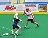Onondaga Redhawks Ryan Lewis (8) fires a shot against the Allegany Arrows in Can-Am Box Lacrosse action at the Onondaga Nation Arena near Nedrow, New York on Saturday, May 14, 2016.  Onondaga won 17-5.