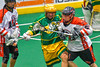 Onondaga Redhawks Cameron Simpson (5) checks a Newtown Golden Eagles player in Can-Am Box Lacrosse action at the Onondaga Nation Arena near Nedrow, New York on Saturday, July 9, 2016.  Onondaga won 14-6.