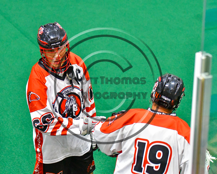 Onondaga Redhawks Captain Brett Bucktooth (66) greets his team as they come out to play the Newtown Golden Eagles in Can-Am Box Lacrosse action at the Onondaga Nation Arena near Nedrow, New York on Saturday, July 9, 2016.