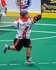 Onondaga Redhawks Kevin Wilkerson (9) reaches for a ball against the Newtown Golden Eagles in Can-Am Box Lacrosse action at the Onondaga Nation Arena near Nedrow, New York on Saturday, July 29, 2016.  Newtown won 10-7.