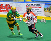 Onondaga Redhawks Hiana Thompson (22) gets stick checked by Newtown Golden Eagles Josh Kacprzak (97) in Can-Am Box Lacrosse action at the Onondaga Nation Arena near Nedrow, New York on Saturday, July 29, 2016.  Newtown won 10-7.