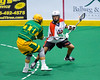 Onondaga Redhawks Leroy Halftown (7) being checked by Newtown Golden Eagles Justin Gill (10) in Can-Am Box Lacrosse action at the Onondaga Nation Arena near Nedrow, New York on Saturday, July 29, 2016.  Newtown won 10-7.