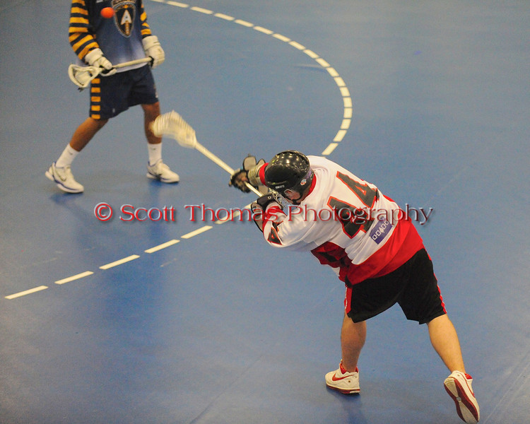 """Onondaga Redhawks Brad Gabriel (44) fires a shot against the Allegany Arrows in Can-Am Senior """"B"""" Box Lacrosse league action at the Onondaga Nation Arena in Nedrow, New York on Sunday, June 26, 2011.  Redhawks won 30-4."""