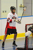 "Onondaga Red Hawks Brett Bucktooth (66) behind the Allegany Arrows net in Can-Am Senior ""B"" Box Lacrosse league action at the Onondaga Nation Arena in Nedrow, New York on Sunday, June 26, 2011.  Redhawks won 30-4."